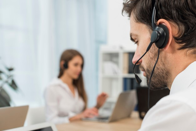 man on call with clients