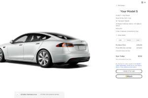 buy a Tesla with bitcoin